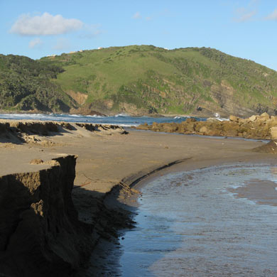 A view of Second Beach, Port St Johns, with Mnthumbane Village on the clifftops across the bay