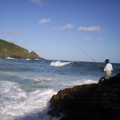 A fisherman on the rocks at Port St Johns